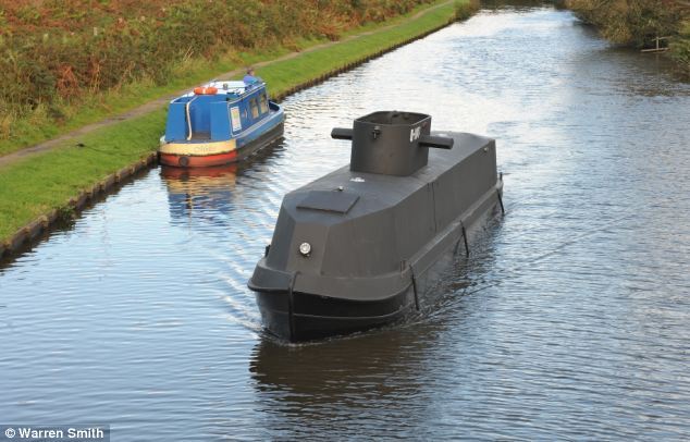 The boat is a much smaller version of the real thing - only a fifth of the size of a real submarine - and is the only floating submarine museum in the world
