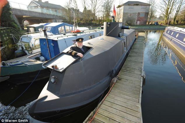 The mock U-8047 u-boat stands out alongside the other canal boats in its new home the dock unlike its previous spot near the Royal Armouries Museum
