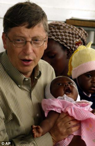 Bill Gates holds a baby in Mozambique during a visit to a local hospital for the Bill and Melinda Gates Foundation