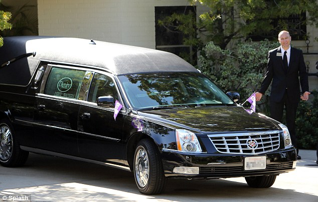 Procession: The hearse was earlier seen arriving at the St. Martin of Tours Catholic Church in Brentwood, Los Angeles this morning, where the funeral took place