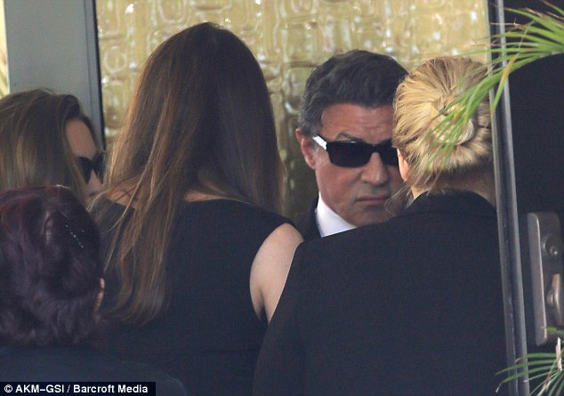 In mourning: The 66-year-old actor had his eyes shielded with sunglasses as he was joined by close family and friends for the service