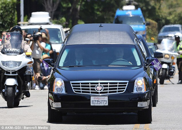 Motorcade: The hearse carrying Sage's coffin left the church surrounded by a police motorcade