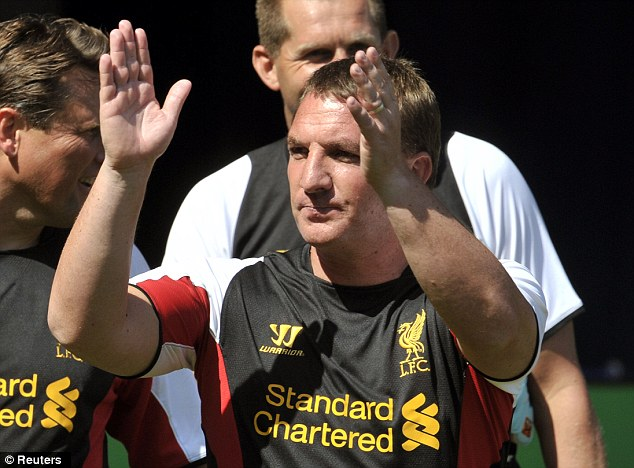 First one out of the way: Brendan Rodgers applauds the fans as he walks off