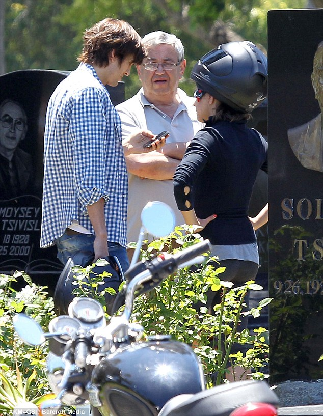 Inseparable: The pair went on a motorcycle ride last week, stopping off at the grave of Mila's grandmother
