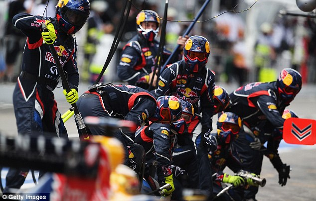 Hard at work: Sebastian Vettel of Germany and Red Bull Racing drives in for a pitstop