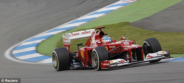 In front: Alonso continues to lead the way in the German Grand Prix