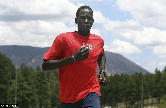 'The dream has come true': Guor Marial, 28, who has no passport and officially no country was cleared by the IOC to compete at the London Games under the Olympic flag