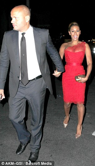 Night on the tiles: Mel looked as though she was enjoying her evening on the arm of her husband, Stephen Belafonte