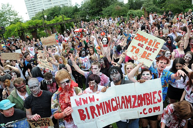 Zombie rising: Those taking part had faces painted in ghoulish grey, along with blood effects for zombie authenticity