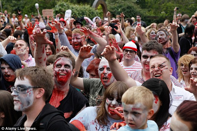 On the march: Blood-soaked participants line up in Birmingham today for the annual Zombie Walk