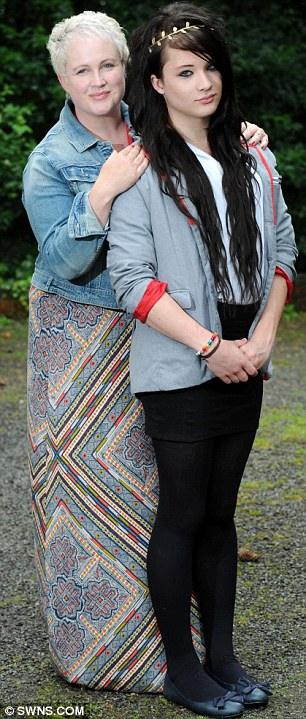 Transsexual Ashlyn Parram, 16, who was told he could not sit his exams unless he wore a boy's uniform, pictured with his mother Miranda