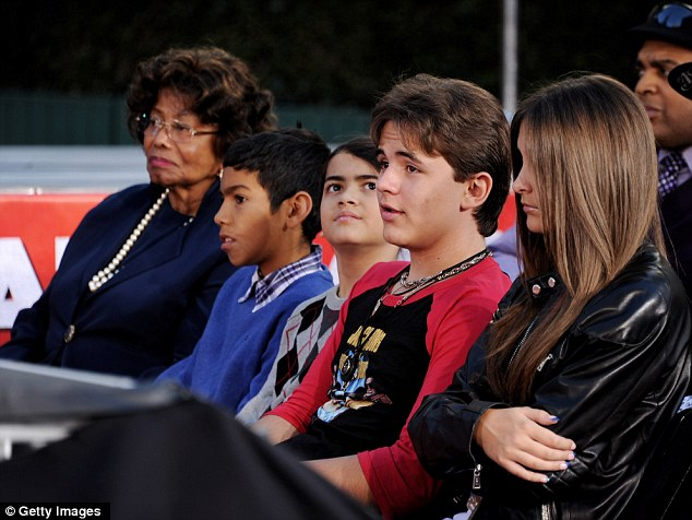 Legal guardian: Katherine Jackson, far left, is guardian to Michael's children Blanket, third left, Prince, center and Paris, right. She and his three children are also Michael's only beneficiaries.
