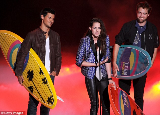 Twilight: Leather-clad Kristen Stewart was joined by Taylor Lautner and Robert Pattinson to accept the Ultimate Choice award onstage during the 2012 Teen Choice Awards at Gibson Amphitheatre