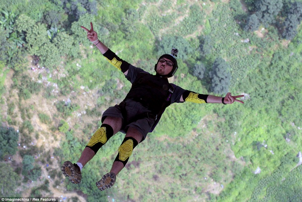 Freefalling: A total of 30 international parachuters from 15 countries took part in the extreme competition from the bridge which is 375m above the swirling waters of the Baling river below