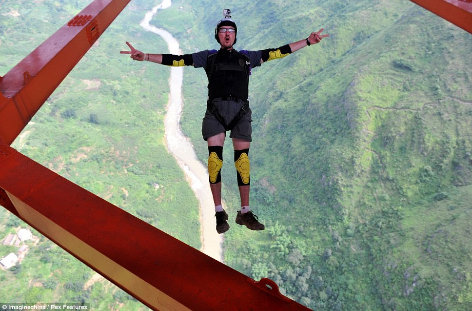 Flying high: A parachute jumper free falls from the world's highest bridge - Balinghe Bridge in Anshun City, China, on Saturday