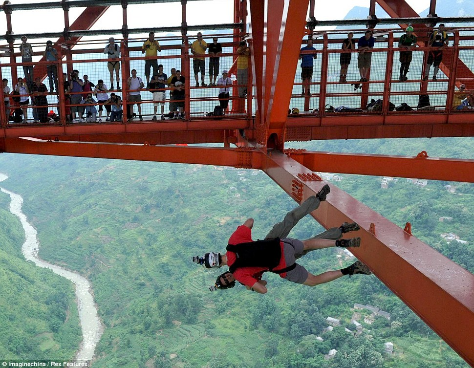 Leap of faith: The 2012 China Anshun Balinghe Bridge Parachuting International Challenge is the first bridge parachuting competition to be held in China