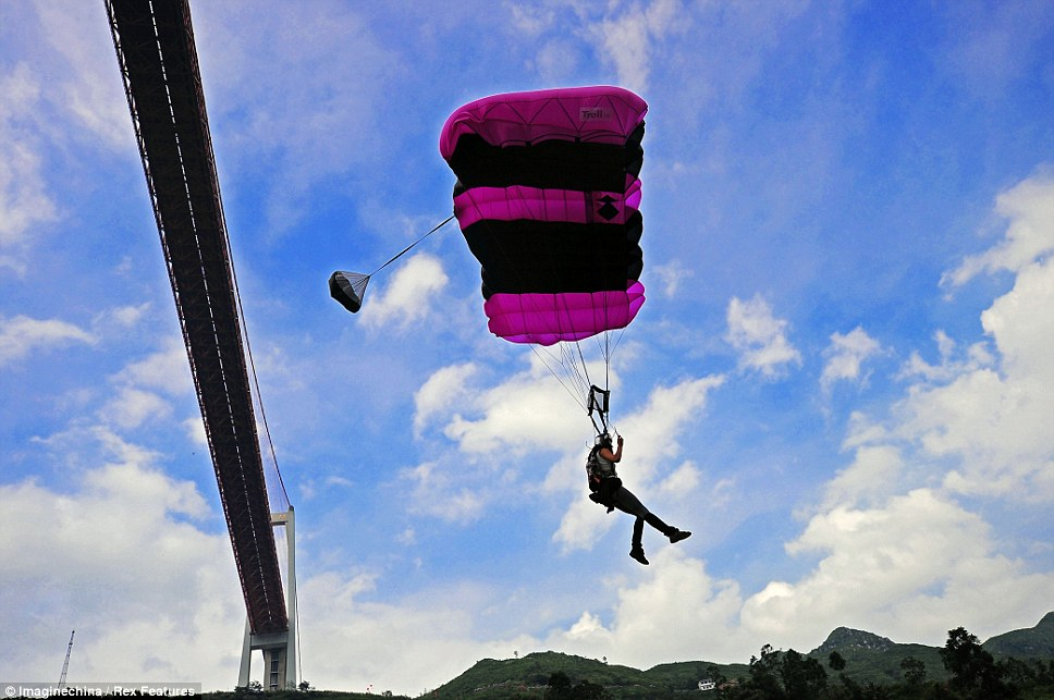 Gliding down: Once the parachute has been opened competitors have to carefully manoeuvre themselves into a position to hit a small target on the ground