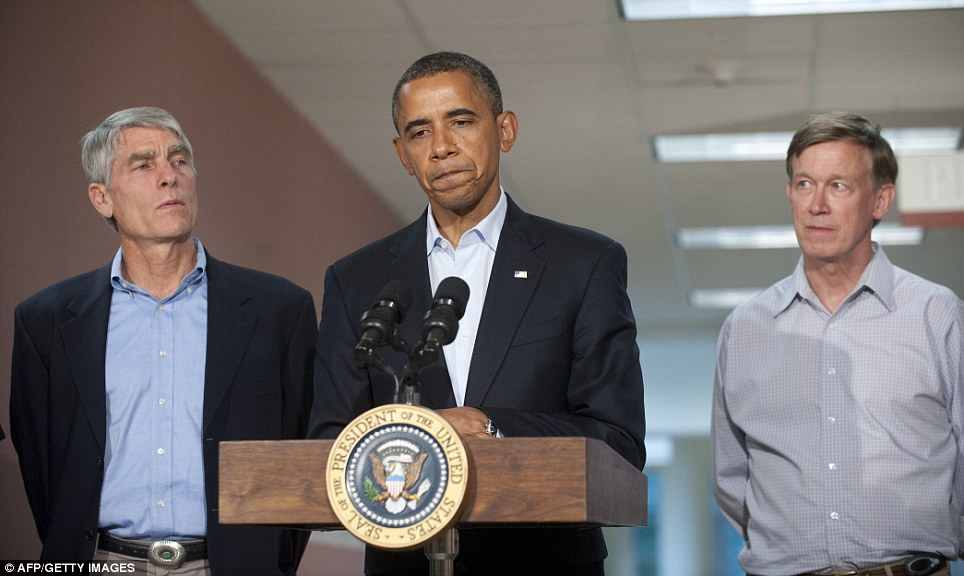 US President Barack Obama alongside Colorado Senator Mark Udall, left, and Colorado Governor John Hickenlooper at the University of Colorado