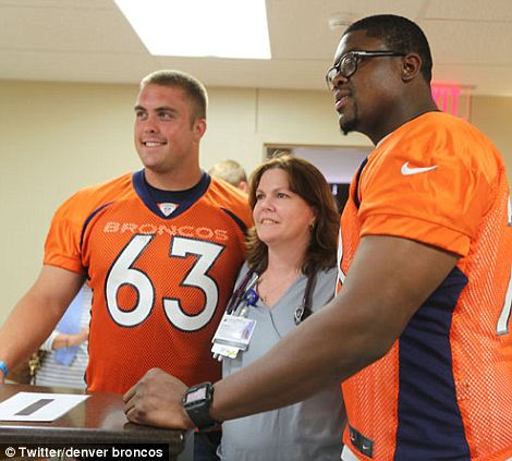Ben Garland (left) and Ryan Clady (right) posed with a nurse
