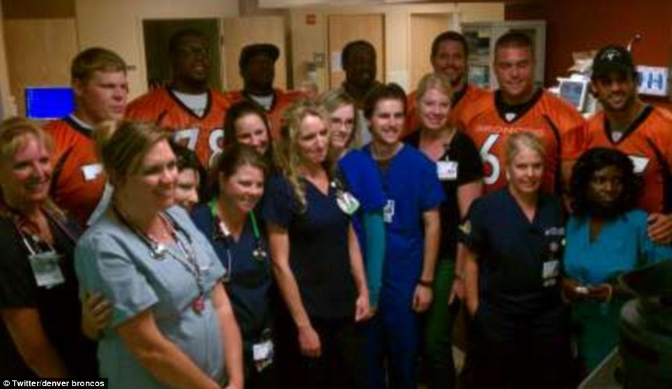 Helping hands: The football players provided a welcome relief for the hospital staffers who had clearly been working long hours since the shooting