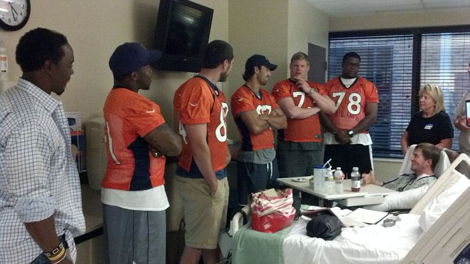 Football fans: Six members of the Denver Broncos NFL team visited a number of the shooting victims who were injured during the attack