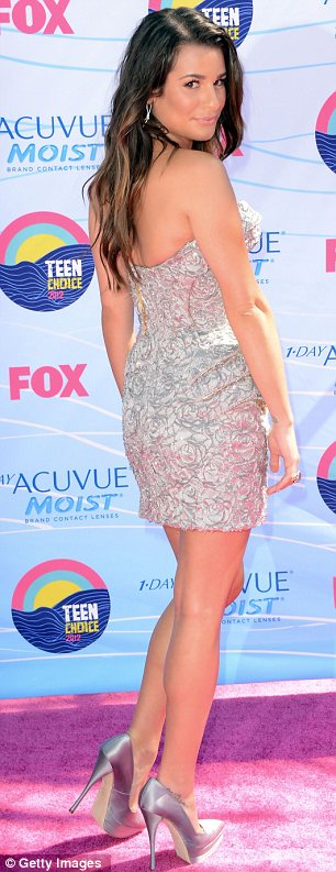 Following suit: As Lea shimmered in silver, Nina Dobrev revealed her figure in a split teal dress