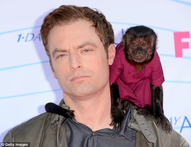 Monkeying around: Weeds star Justin Kirk certainly turned heads when he arrived with a monkey on his shoulder