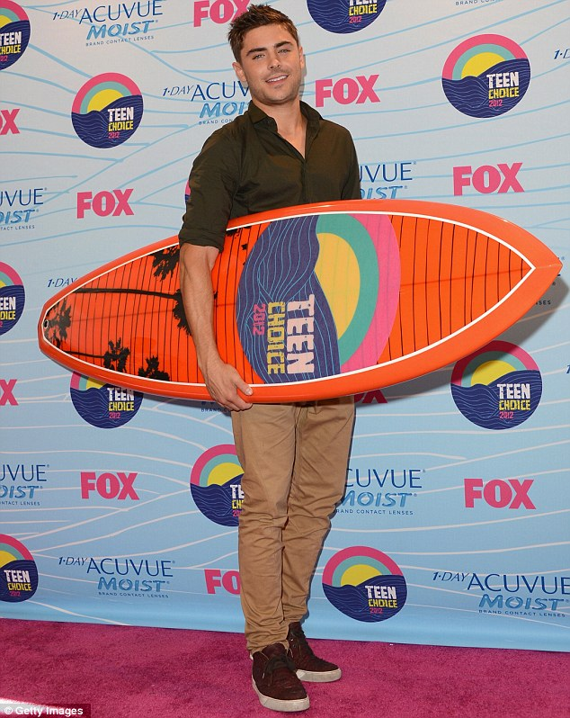 Everybody's surfing now: Zac Efron looked happy with his award