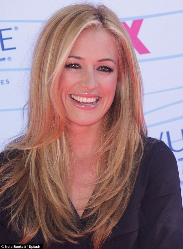 British rose: Cat Deeley looked pretty as she beamed at fans and photographers
