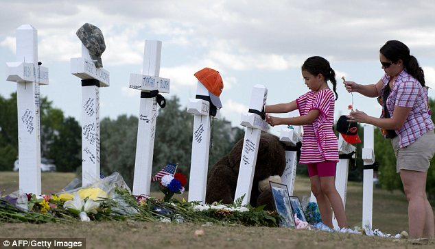Tribute: The crosses erected near the site of the massacre in memory of Holmes's 12 victims