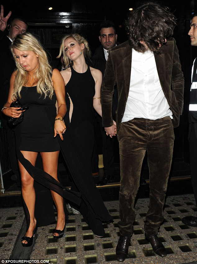 Signs of a good night: Diana was led out of the club by her boyfriend and a friend