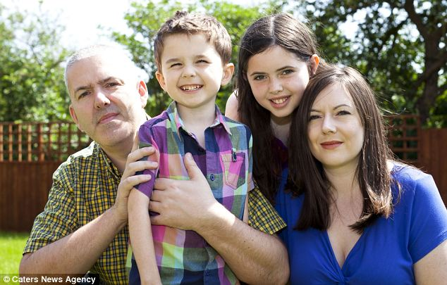 Daniel with his parents Kevin and Catherine and his elder sister Hannah. Kevin said their dream is to have Daniel eat at the dinner table