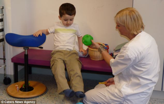 Daniel during treatment in Austria. His parents had to raise £25,000 to pay for it