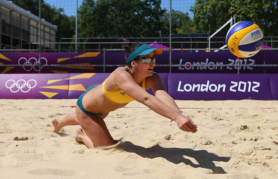 Becchara Palmer makes a dive for the ball during the Australian Beach Volleyball training session