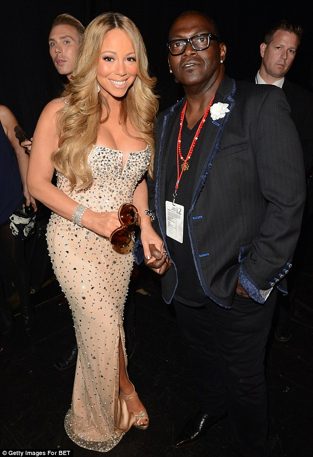Close pals: Mariah and Randy Jackson cuddled up at the BET Music Awards earlier this month