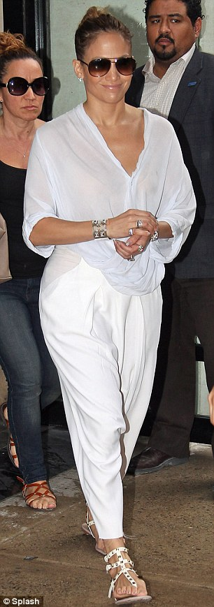 Billowing: The singer wore a billowing ensemble featuring white trousers and a very light blue shirt