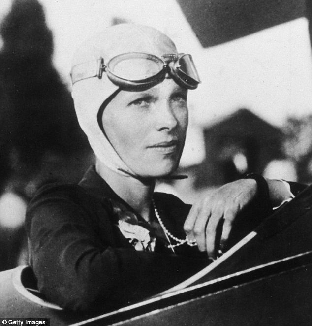 Amelia Earhart sits in the cockpit of her plane, circa 1925