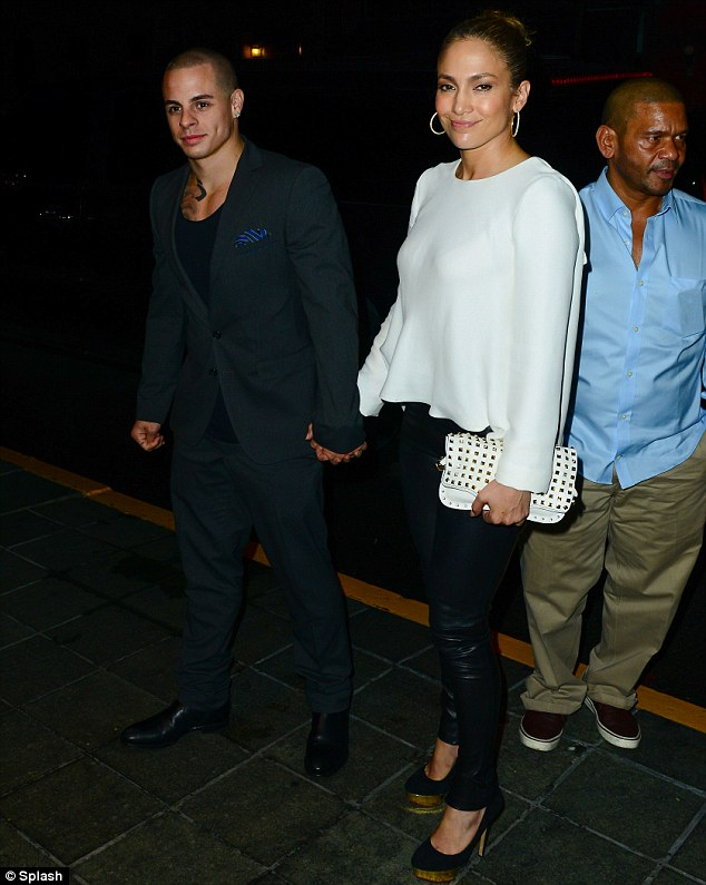 Hand-in-hand: Jennifer looked entirely smitten with her 25-year-old boyfriend as the pair headed out
