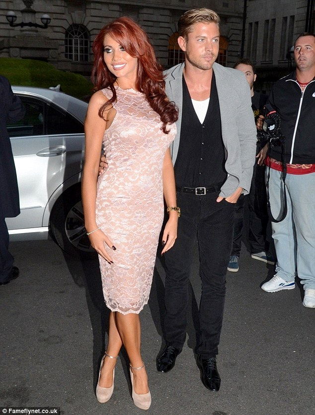 Helping hand: Amy Childs revealed that her boyfriend David Peters has been helping her recover from her second breast enlargement surgery