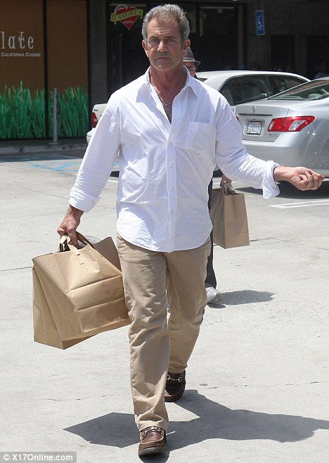 Legal woes: Mel Gibson, pictured out in Malibu yesterday, is being sued by his stepmother