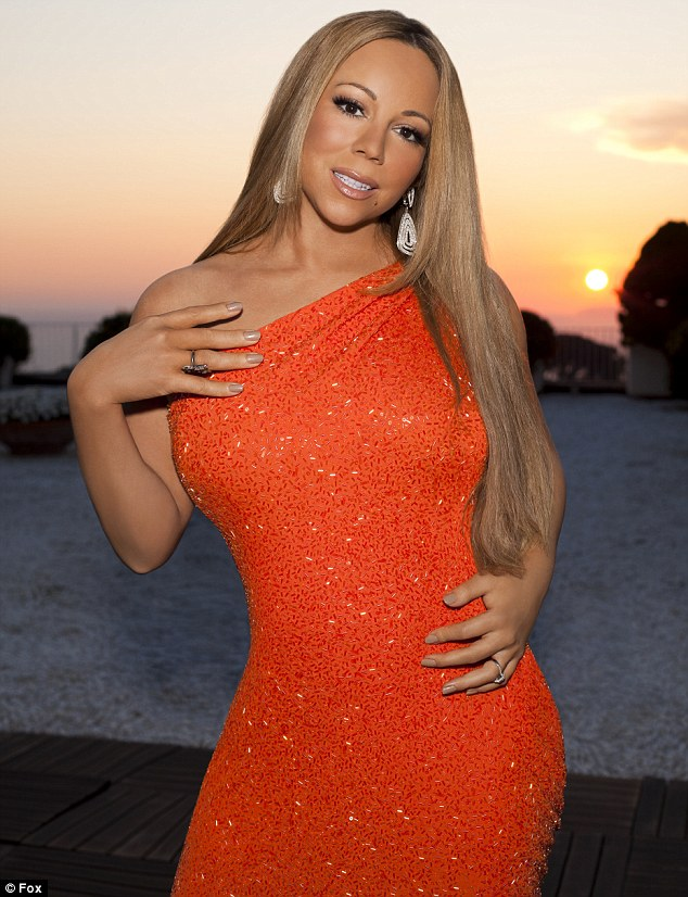 Sparkling in orange: This official picture of new American Idol judge Mariah Carey was released shortly after the news of her new role broke