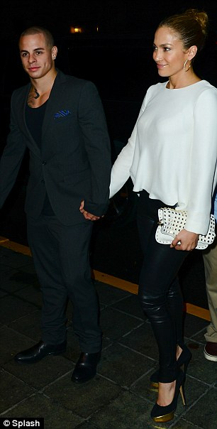 Accessory queen: Jennifer topped off her outfit with a cream studded clutch bag and hooped earrings