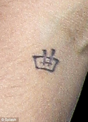 Symbolic: Justin's tattoo is the Japanese Kanji symbol for music