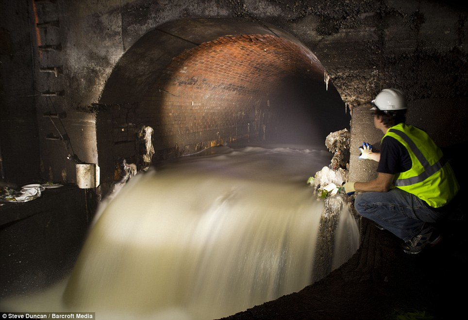 Hold your nose: Urban explorer Steve Duncan surveys a sewer outfall in Wallabout, one of the oldest areas of Brooklyn, New York, as he sets about capturing the unseen areas of the city