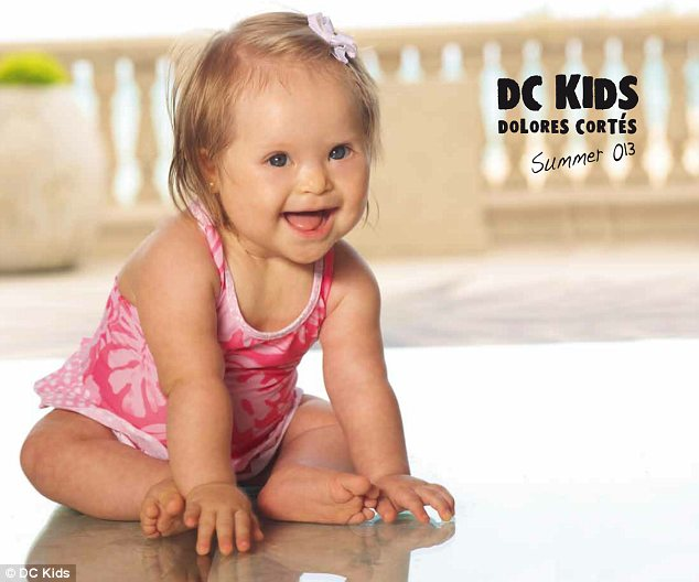 Born star: A ten-month-old baby who suffers from Down syndrome, Valentina Guerrero (above), has appeared on the cover of a catalogue for Spanish designer Dolores Cortes' new swimwear collection