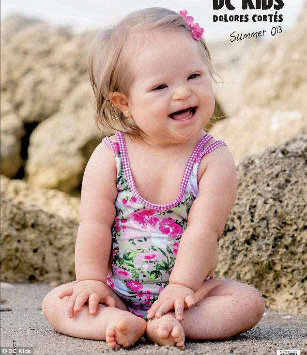 Smiles: The toddler is seen modelling a range of colourful swimwear options for tiny tots in the catalogue