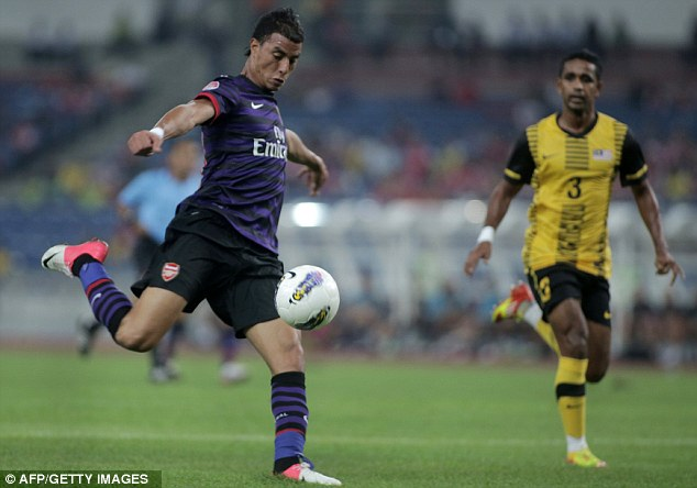 Getting close: Marouane Chamakh and Gervinho both had good chances, but wasted them