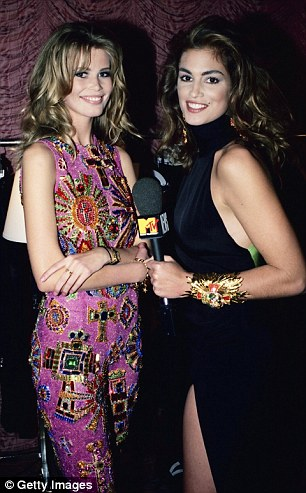 Iconic faces: Cindy Crawford interviews supermodel Claudia Schiffer (left) who is wearing Gianni Versace backstage at his 1991 show