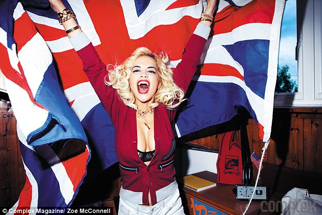 Flying the flag: Rita Ora shows off her sexy side while admitting she is just 'like a dude'