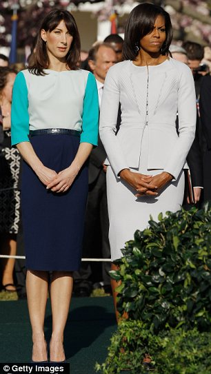 First Lady Michelle Obama (R) and Samantha Cameron talk during the official arrival ceremony at the South Lawn of the White House March 14, 2012